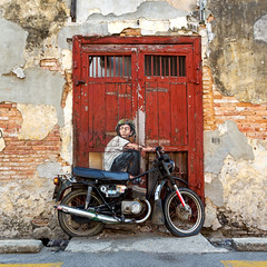 Boy on a Bike (Rob Kroenert) Tags: street boy art bike painting town george asia georgetown malaysia motorcycle penang southeast ernest peninsula peninsular my zacharevic