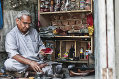 The Maker of New Shoes at Solan (Anoop Negi) Tags: street india photography shoe photo hp shoes business worker kiosk bazaar middle maker anoop himachal profession negi solan ezee123