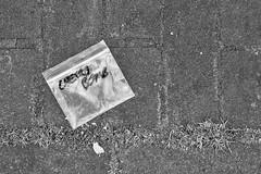 Amsterdam in a bag (Arne Kuilman) Tags: street blackandwhite netherlands amsterdam weed nederland olympus filter hash cherrybomb straat em10 hennep zakje supertakumar35mm cc03yellow