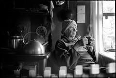 Granny (mkberquist) Tags: motion cold kitchen 35mm cabin tea rangefinder olympus steam lightleak kettle hp5 oldlady rodinal ilford woodstove olympusxa hp5plus bulkrolled