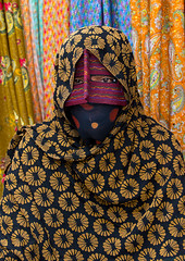 a bandari woman wearing a traditional mask called the burqa at panjshambe bazar thursday market, Hormozgan, Minab, Iran (Eric Lafforgue) Tags: portrait people woman vertical outdoors persian clothing asia veil mask iran muslim islam religion hijab culture persia headshot hidden covered iranian bazaar adults adultsonly oneperson traditionaldress burqa customs ethnicity middleeastern sunni burka chador balouch hormozgan onewomanonly burqua  bandari  embroidering 1people  iro thursdaymarket  minab unrecognizableperson colourpicture  borqe panjshambebazar boregheh iran034i2662