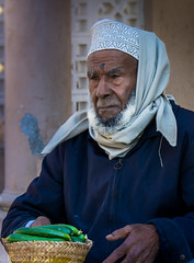 Portrait of an Old Vegetable Seller, Oman (Peraion) Tags: old man face hat asia middleeast oman cucumbers arabianpeninsula