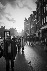 Light and shadow (A blond-Tess) Tags: people blackandwhite sunlight holland netherlands monochrome amsterdam backlight canon outdoors blackwhite europe shadows candid january streetphotography sunny 7d shoppers candidphotography canonphotography outdoorphotography sigma1750mmf28 tessaxelsson