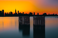 Manhattan on Fire (c_slavik) Tags: new york city nyc sunset sky urban orange skyline architecture sunrise buildings river colorful long exposure cityscape manhattan filter nd hudson