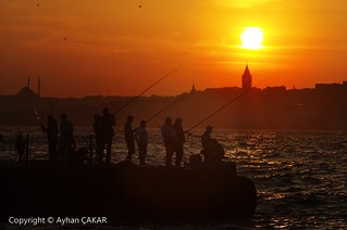 Sunset Bosphorus Istanbul and Fishermen