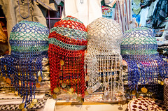 Beaded head covering (Tex Texin) Tags: shop booth colorful veil crafts middleeast hats souk vendor oman seller muscat beaded muttrah headcovering mutra