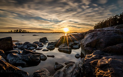 Art of light (Mika Laitinen) Tags: ocean longexposure sunset sea cloud sun seascape tree nature rock suomi finland landscape helsinki outdoor cost wideangle shore fi scandinavia rayoflight vuosaari uusimaa kallvik tokina1116mm canon7dmarkii