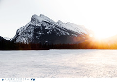 Mount Rundle at sunrise by Vermilion Lakes in winter close to the town of Banff in Alberta (Vincent Demers - vincentphoto.com) Tags: voyage ca trip travel winter sun sunlight mountain canada nature montagne sunrise landscape rockies soleil hiver alberta banff traveling paysage sunbeam mountrundle sunray frozenlake sunflare banffnationalpark winterlandscape canadianrockies winterscene travelphotography travelphoto traveldestinations vermilionlakes leverdusoleil traveldestination paysagedhiver photographiedevoyage photosdevoyage photodevoyage improvementdistrictno9 travellocations travellocation