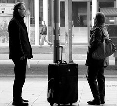 Two and a roller case (Akbar Simonse) Tags: street people urban bw holland blancoynegro netherlands monochrome station zwartwit candid nederland streetphotography bn luggage bagage straat koffer straatfotografie img8245 rookpaal rollercase rolkoffer akbarsimonse