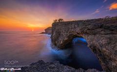 Pasih Uwug in Other Sunset (PhiladelphiaHVAC165) Tags: ocean sunset bali sun seascape canon indonesia photography landscapes rocks long exposure nusa penida 500px 500pxprime