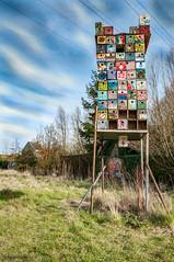 Red cross building (ericbaygon) Tags: bird art nikon paint cross belgium belgique box dessin does oiseau bote dx abris nikonpassion d300s