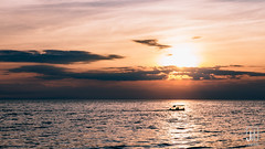 A Small Boat and a Sunset (Jim Makos) Tags: sunset sea sky sun clouds boat greece sail gr float timeless calmness macedonian makedonia kalamaria  macedoniagreece makedoniathraki