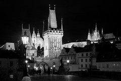 Gothic City (McQuaide Photography) Tags: old city longexposure nightphotography travel light blackandwhite bw building tower castle history tourism monochrome architecture night zeiss outside mono blackwhite gate europe prague outdoor sony tripod gothic praha landmark praskhrad historic 55mm czechrepublic fullframe alpha charlesbridge oldbuilding touristattraction praag lessertown manfrotto c1 praguecastle gothicarchitecture czechia centraleurope sonnar karlvmost malstrana capitalcity bridgetower eskrepublika captureone mirrorless sony55mmf18 mcquaidephotography a7rii ilce7rm2 captureonepro9