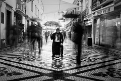 No where to go (Vitor Pina) Tags: street city cidade portrait people urban man streets men monochrome rain contrast umbrella portraits photography pessoas moments cityscape shadows outdoor candid streetphotography urbano rua conceptual scenes pretoebranco momentos