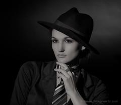 A woman with attitude (Susan Newgewirtz) Tags: portrait people blackandwhite woman beautiful hat interesting indoor studiowork