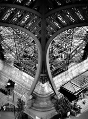 Eiffel Symmetry (richard.scott1952) Tags: world street leica old city trip travel shadow blackandwhite bw paris building tower art heritage history classic industry monochrome look fashion stone wall architecture vintage garden temple store twilight iron steel interior scrollwork trix decoration victorian culture eiffel monochromatic carving best steam storefront tradition m6 leicasummicron50mmf20rigid