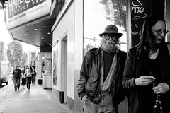 Real Live Theater (Warfield360) Tags: street trees sky people woman man beer hat sign bar reflections beard marquee glasses hands eyecontact theater expression candid couples jacket trailer gesture boxoffice droptop