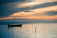 Morning delight (Karthikeyan.chinna) Tags: travel light sea sun india beach nature water silhouette clouds sunrise canon boat transport 5d chennai seashore tamilnadu rameswaram lightplay karthikeyan cwc chinna chennaiweekendclickers chinnathamby