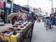 H504_3194 (bandashing) Tags: street england people man water manchester tin pull shops push cart rickshaw sylhet bangladesh tins watercarrier socialdocumentary aoa bandashing akhtarowaisahmed