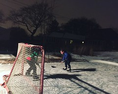 (Ryan Dickey) Tags: game ice hockey night backyard luke moonlight evanston neighbors fridaynight oneonone pickupgame outdoorhockey neighborhoodhockey