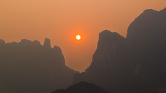 (n0mad.mu) Tags: sunset sun mountains nature forest landscapes haze review cliffs limestone lush laos karst dryseason forested