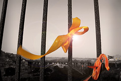 a touch of color (*ameLIE*) Tags: life bridge sky bw italy color love monochrome yellow sepia cutout out landscape hope italia cut ponte bow ribbon amore bnw sicilia selective fiocco nastri