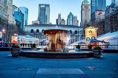 Bryant Park Fountain freezes.. (mitzgami) Tags: nyc newyorkcity winter nikon flickr manhattan bryantpark frozenfountain bryantparkfountain nikonphotography bryantparknewyork d7000