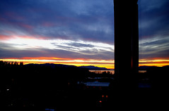 Bellingham sunset in my window (nownowfatcat) Tags: ocean trees sunset sun seascape mountains reflection window beautiful clouds evening bay twilight colorful sundown dusk vibrant rich vivid frame multicolored brilliant radiant nightfall gloaming  eventide colorfulcityscape