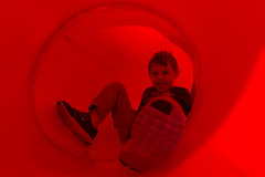 Sliding Down a Red Tube [Explore] (aaronrhawkins) Tags: park boy red color playground children foot utah spring child joshua tube twist slide tint stop sick hue slippery twisty enclosed orem scera aaronhawkins scerapark