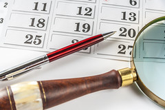 Pen And Magnifying Glass On Calendar (AudioClassic) Tags: closeup pen calendar time nopeople magnifyingglass number whitebackground data reminder finance searching concepts forecasting analyzing goldcolored makingmoney lookingthroughanobject calendardate lensopticalinstrument