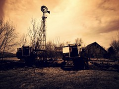 the last crop... (BillsExplorations) Tags: abandoned water windmill sepia vintage decay farm country forgotten waterpump ruraldecay harvester ih farmmachinery hww windmillwednesday
