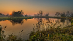 Silence by the river (piotrekfil) Tags: sunset sky sun mist nature water wow reflections river landscape pentax poland piotrfil