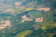 20160423_F0001: Close encounter in flight (wfxue) Tags: houses lake field turn plane landscape countryside flight aerial roads passengerplane passengerjet windowsit