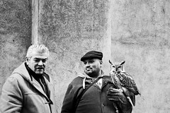 The Good, the Bad and the Ugly (catarinae) Tags: street travel two portrait bw white man black monochrome animal republic czech prague good bad ugly owl the