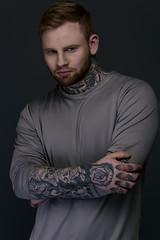 Tyler Oakes (JamesAnthony94) Tags: portrait orange colour male beautiful dark grey model moody tattoos muted