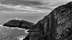 it's out there in all weather (lunaryuna (off to Iceland for 2 weeks)) Tags: light sea sky bw panorama cliff lighthouse seascape monochrome beauty weather wales landscape coast blackwhite rocks solitude wake waves mood elements isolation lunaryuna northwales southstack harshness angleseyisland mellowness holyheadlighthouse
