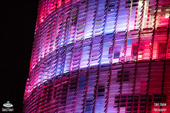 Torre Agbar, Barcelona illuminated (ChrisKarun) Tags: world barcelona city windows abstract color building texture geometric les skyline architecture skyscraper wonderful de spain pattern torre jean bright outdoor may catalonia diagonal badajoz curve carrer nouvel agbar poblenou rascacielos plaa gratacels glries avinguda catalanes