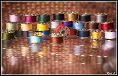 fil  coudre (baladeson) Tags: colors thread lumix couleurs sewing sew reflets reflects fils sewingthread bobines panasoniclumixg30mmmacrof28 bobinesdefils ncessairedecouture