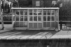 (Delay Tactics) Tags: shadow 2 bw white 3 black station train platform railway boring bland shelter tring banal