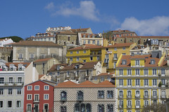 Houses on a hilltop in LIsbon, Portugal (jackie weisberg) Tags: city houses homes portugal lisbon capital cities eu bluesky facades tiles hilltop colorfulhouses capitalcity hilltophouses jackieweisberg