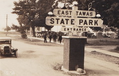 NE East Tawas MI RPPC Just East of Downtown Stores & Businesses this Great State Park Entrance View Tent Camps setup Playground to the right Lake Huron Tawas Bay straight ahead1 (UpNorth Memories - Donald (Don) Harrison) Tags: travel usa heritage history tourism st vintage antique michigan postcard memories restaurants hotels trailer roadside upnorth steamship cafes excursion attractions motels mackinac cottages cabins campgrounds city bridge island car upnorthmemories rppc wonders big railroad michigan memories mac state parks entertainment natural harrison roadside ferry travel don tourist mackinaw stops upnorth straits ignace