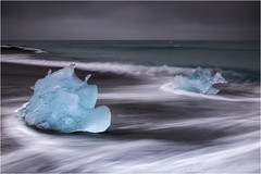 Travellers (Maciek Gornisiewicz) Tags: sea seascape motion black ice beach clouds canon landscape photography iceland europe travellers wave filter iceberg maciek jokulsarlon 2015 darkelf 24105mm breiðamerkursandur gornisiewicz 5diii