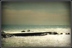 calm before the storm (kurtwolf303) Tags: ocean barcelona sky people espaa seascape storm topf25 water dark spain topf50 topf75 wasser europe 500v20f dramatic himmel thunderstorm topf100 catalua spanien 800views seaview compactcamera katalonien unwetter 900views 750views 1000v40f 250v10f flickrelite unlimitedphotos nikoncoolpixs8200