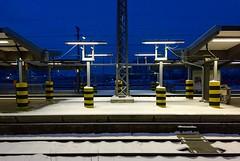 Platform (XoMEoX) Tags: hauptbahnhof augsburg symmetry gelbschwarz schwarzgelb db bahn verschneit schnee snow iphone6 iphone dawn beleuchtung lamps lampen lamp morgen morning blau blue bahnhof station bahnsteig platform
