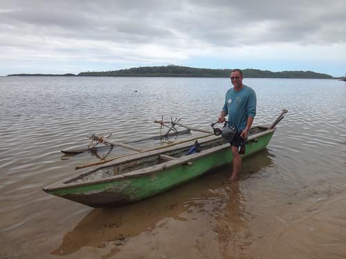 Old tech - canoe; new tech - camera