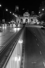 Puerta de Alcala...Welcome to Madrid (A.J. Paredes) Tags: madrid city urban blackandwhite bw espaa moon blancoynegro car architecture night canon buildings eos rebel lights luces noche photo spain arquitectura edificios puerta gate exposure downtown view ciudad center luna bn coche vista vehicle monumentos monuments cibeles alcala vehiculo 700d ajota85 ajparedes