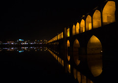 a view of the si-o-seh bridge at night highlighting the 33 arches, Isfahan Province, isfahan, Iran (Eric Lafforgue) Tags: city travel bridge urban reflection building tourism horizontal architecture night buildings outdoors persian asia arch iran middleeast bridges engineering persia arches nobody landmark architectural illuminated civil iranian centralasia esfahan isfahan ispahan siosehpol   siosehbridge  iro isfahanprovince  colourpicture polesioseh  hispahan iran034i3684