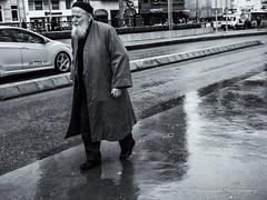 Street 78 (`ARroWCoLT) Tags: street old white man black reflection wet monochrome sepia walking photography blackwhite day alone samsung mini istanbul sidewalk rainy f18 taksim beyaz kaldrm sokak ois nx 17mm siyah nxm nxmini
