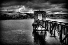 Piethorne Valley Reservoir (Missy Jussy) Tags: trees light england sky bw water monochrome clouds reflections landscape outside mono countryside blackwhite shadows northwest outdoor structures reservoir lancashire hills valley views pylons ogden pumphouse piethorne newhey