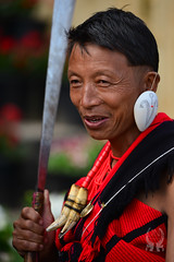 Hornbill Festival, Nagaland 2015 (Josh Niederauer) Tags: travel red portrait people india man black male men tourism face hat festival asian nikon afternoon zoom head traditional north culture tribal east sword if warrior hunter 28 tradition nikkor tribe ethnic dao 70200 hornbill vr cultural lense naga d800 nagaland attire 2015 kisima tigerteeth
